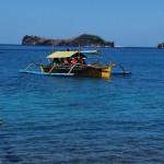 Big bangka on the sea - islands on the background