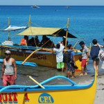 People getting to a bangka